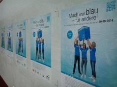 Foto mit Plakaten zum Freiwilligentag in der Heidelberger Hauptstrasse
